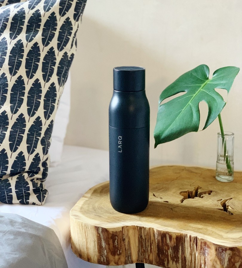 Lifestyle and parenting blog LifeByVal. Image: Larq bottle on artistic wooden nightstand.