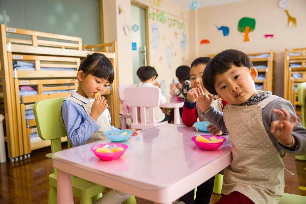Lifebyval parenting and lifestyle blog. Image: Kids eating fruit and daycare.